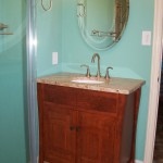 Artisan Group made the vanity to recreate on in a catalog for 1000's more. Recessed medicine cabinet, Travertine floor.