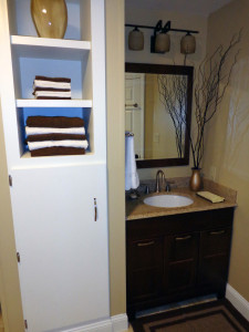 Basement bathroom. The custom cabinets to the left of the sink contain the up-pumping equipment so the shower, sink, etc all connect to the drain lines properly.