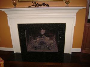 Detail of the wood surround. New log set runs off of gas.