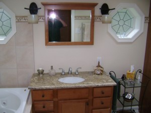 House damaged in a storm. Bathroom was a total loss so we were able to redesign with octagon-shaped windows and a spa tub.