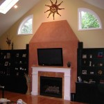New addition fireplace, custom cabinets and surround, American Clay treated chimney, and tile hearth.