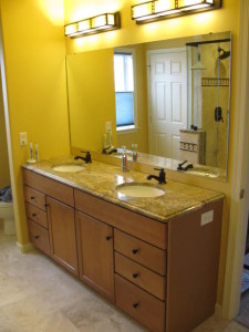 Original vanity had new granite and faucets added as part of a partial remodel of the master bathroom.