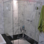 Restored the marble, re-grouted with epoxy grout and a new glass enclosure, (all by The Home Artisan Group).