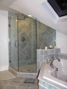 Shower stands where a closet used to. Custom glass work also by The Home Artisan Group.