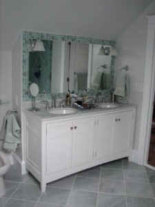 This bath was added in the attic area of the house. We brought the side wall out far enough to handle a full height mirror. Next to it are the toilet and bidet, which recess a bit further. All custom work.