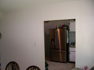 1. BEFORE wall removal. The fridge is where the range is after...