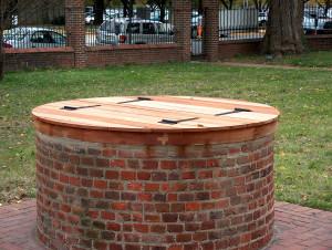 Brick re-pointing and a custom Spanish cedar well cap.
