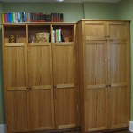 Custom oak cabinets for a locker and pantry area. We restored the hardwood floors also.
