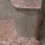 Custom radiused bench seat in a shower.