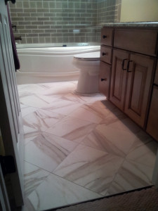 Diagonal pattern helps a small bath appear larger.