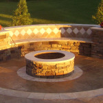 Fire pit with a permanent radiused bench to compliment the circular shape.