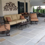 Flagstone patio and a veneer retaining wall.