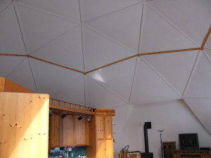 Geodesic dome needed a paint job after 25+ years of fading. We added the trim to cover cracks inherent to the design, then came up with the concept of having stained pieces around the lower ring.
