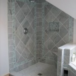 Glas and marble coming together to form another outstanding tile job.