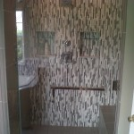 Glass tile on the walls, porcelain on the floor and a bench seat.