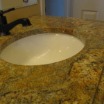 Golden beach granite on top of an existing vanity with a california faucet added.