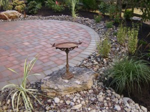 Gravel beds are often used to keep hardscaping cleanly separated from the planting beds or grass.