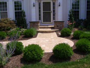 Hardscaping and softscaping coming together to make a very stately entrance.