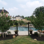Hardscaping, waterfall, estate fence, pool and plantings by HAG.