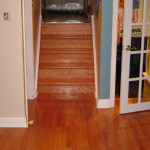 Installed new flooring and then we re-finished the stairs to match.