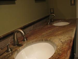 Juparanna granite top with tile backsplash. Completed with Delta fixtures.