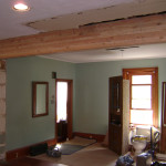 Large load bearing wall came out to connect the kitchen and dining room of this 100+ year old house.