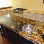 Magma gold doubled up for a kitchen island. The island was custom designed and built by HAG. Perimeter counters are colonial gold.