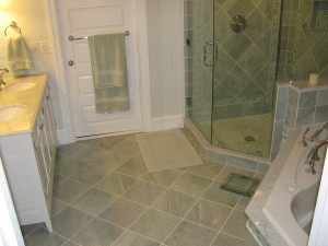Marble on the floor, marble and glass shower walls, solid marble sills for tub and shower, a countertop, plus a seat in the shower.