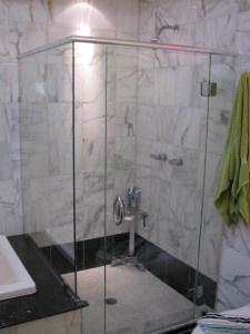 Modern house with a marble bath that was outdated and leaking. Re-grouted with epoxy grout and added a new shower glass set up (custom from HAG).