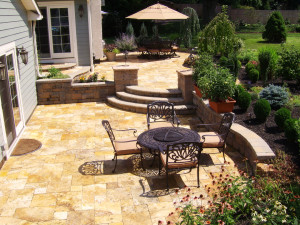 Multi level Travertine patio with some beautiful curved stairs in between.