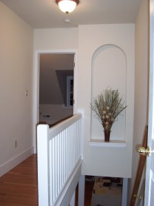 Niche added to a stairwell to add some flair to a house flip.