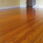 Oak flooring, sanded to bare wood, then stained and finished.