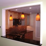 Pendant lights in a newly created opening between the kitchen and living room.