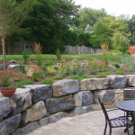 Putting in this retaining wall helped create two flat areas, one for sitting and another for planting.