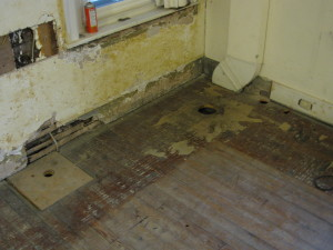 Remnants of where a powder room was crammed into their 1st floor. These floors are going to be restored to their original glory.