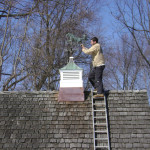 Restored cupola and weather vane going back in place.