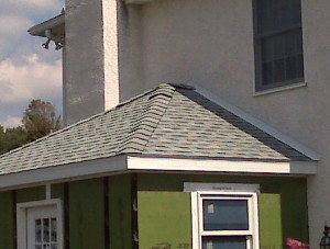Small roof on top of a small addition.