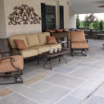 Stucco and stone veneer floor with a vinyl ceiling for this porch.
