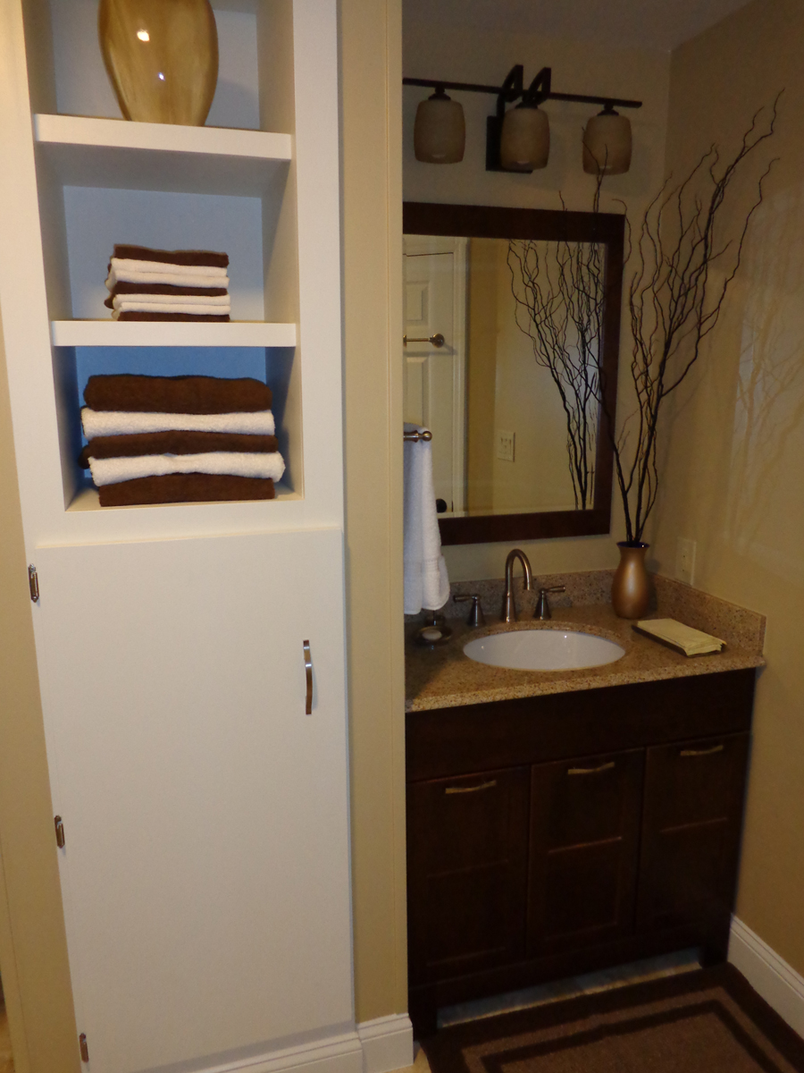 Tall Built In Cabinet Designed To Store Bathroom Stuff And