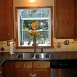 This Garden window was the hinge point of this kitchen design. It is much smaller than the old unit and allowed for more cabinets flanking it. Re-working the siding on the outside does not concern us.