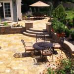 Travertine patio with block retaining walls.