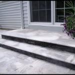 Travertine rear steps.