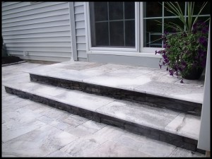 Travertine rear steps.