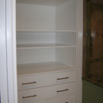 Ultra-functional cabinet built and placed in a full bath remodel.