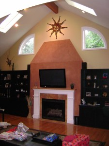 We painted the custom cabinets and wall and had a specialist apply American Clay to the chimney.